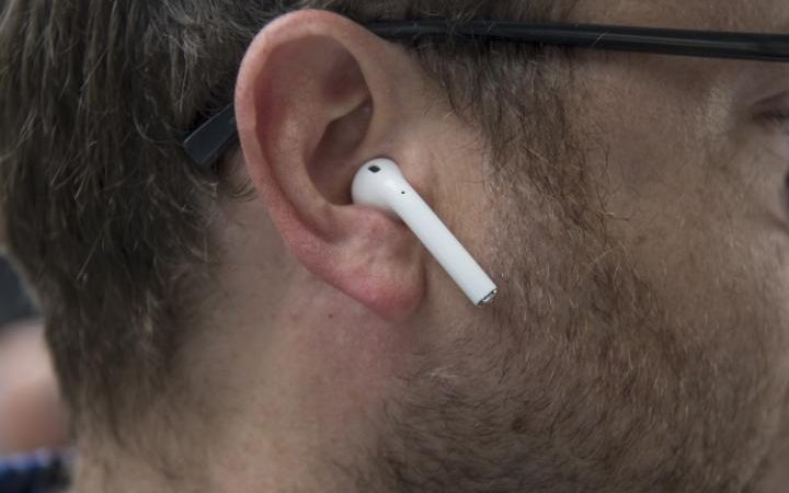 An attendee wears the AirPod headphones at the San Francisco event